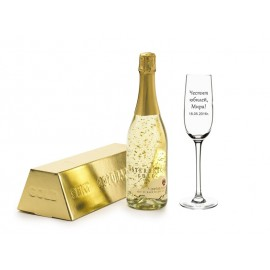 Champagne with golden pieces and a glass